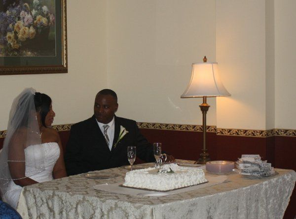Bride and groom with wedding cake.