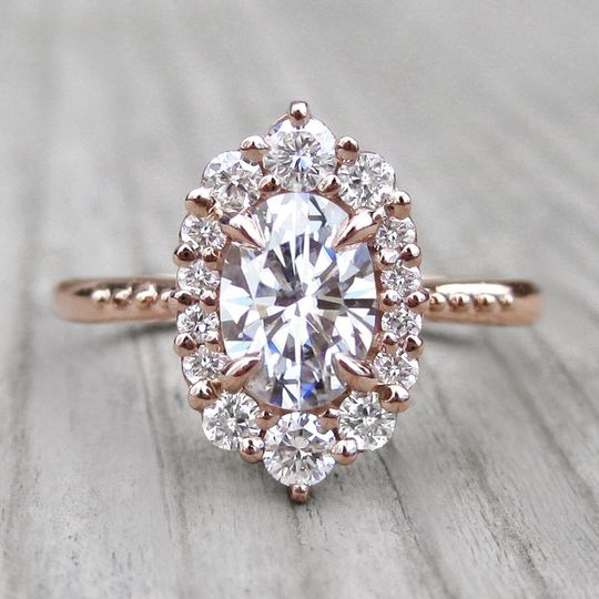 The small Sofia, a forever one oval moissanite with conflict-free canadian diamond halo in rose gold