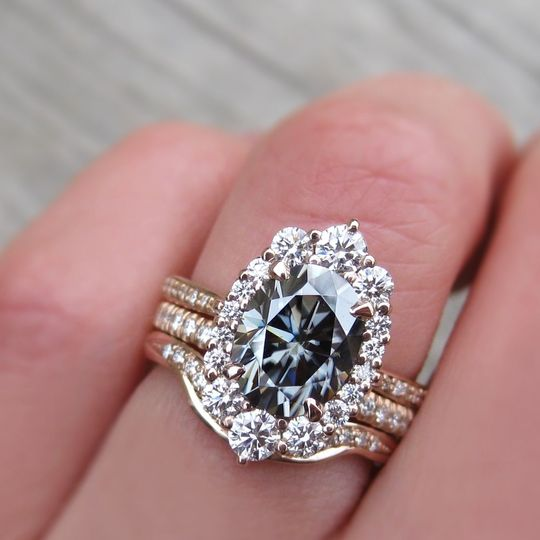 The large Sofia, an Iconic grey oval moissanite and diamond halo