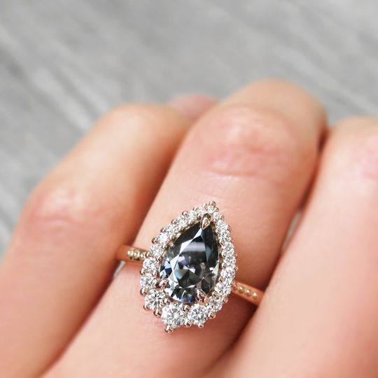 The Celeste, an iconic grey pear mosisanite and canadian diamond halo