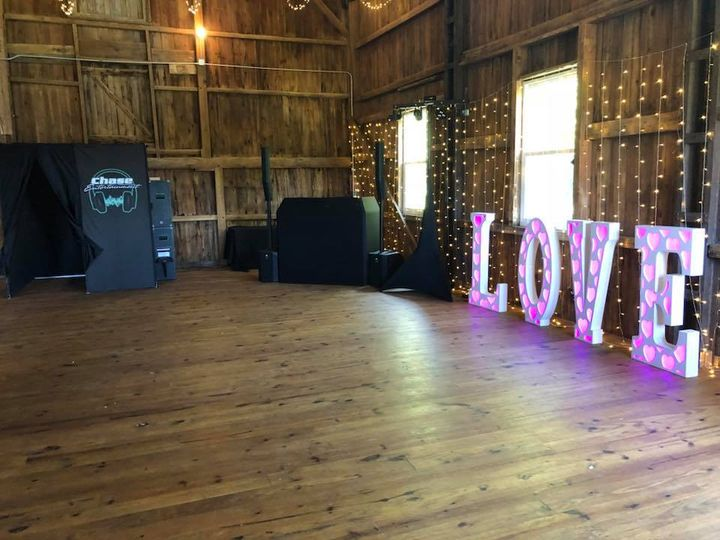 Photo booth, DJ setup, and love sign