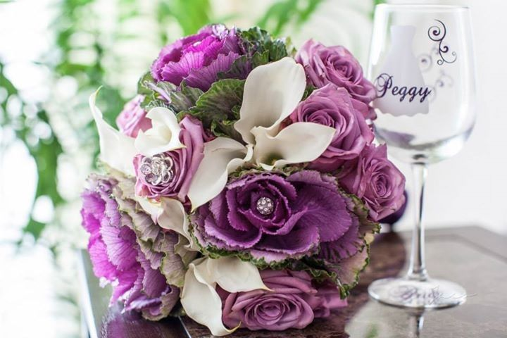 Violet bouquet and wine glass