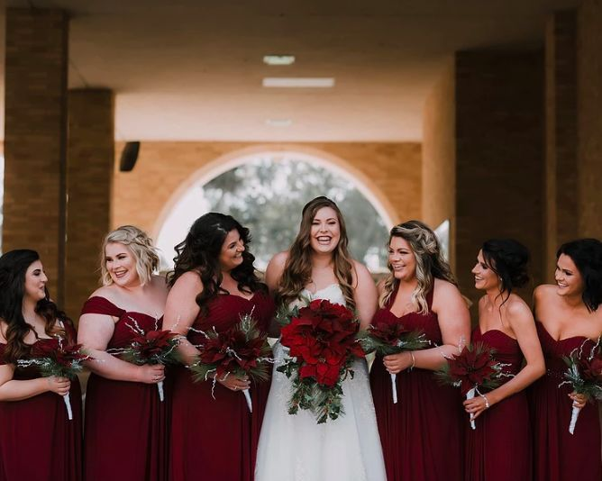 Bride, bouquets, and bridesmaids