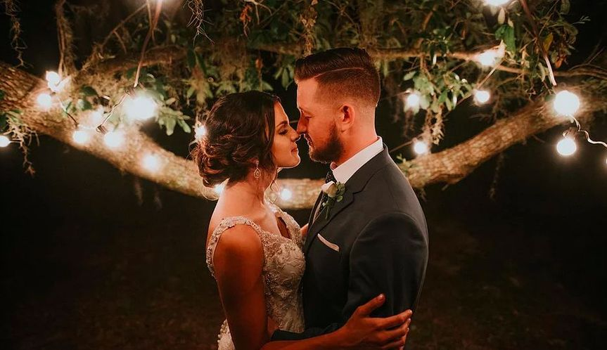 Newlyweds by the lights