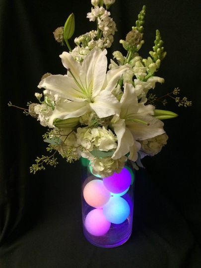 Easy centerpiece.  Add 5-6 Styr-O-Lites in a tall cylinder vase.  Ask your florist to make an oasis...