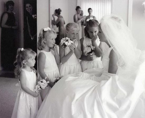The Bride and the flowergirls talk over the last minute details before the wedding ceremony at the...