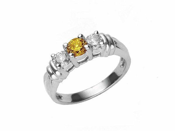 Photo of our yellow diamond in a ring setting. We  do offer settings for your diamonds.