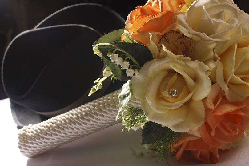 Natural Look Wedding Bouquet Coiled holder. Ivory and Peaching/Orange in color. Roses.