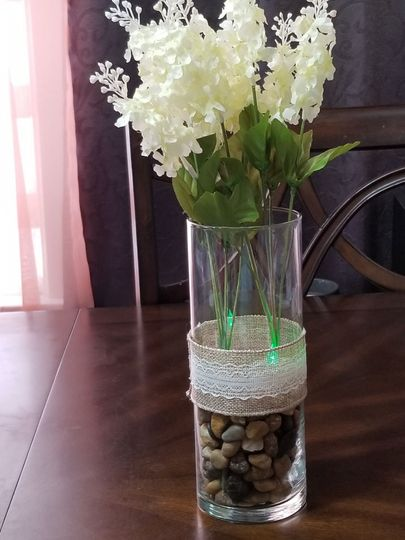Floral table centerpiece with green lights
