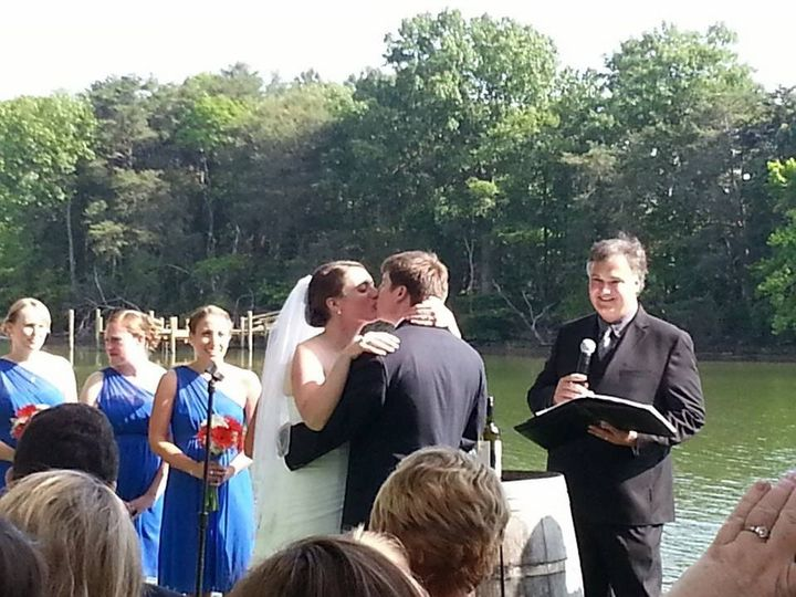 The magic moment... Officiating a wedding at the beautiful Slack Winery in Ridge, Maryland.