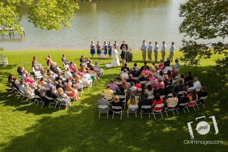 A view from the balcony of Slack Winery in Ridge, Maryland overlooking the wedding of Ashley and...