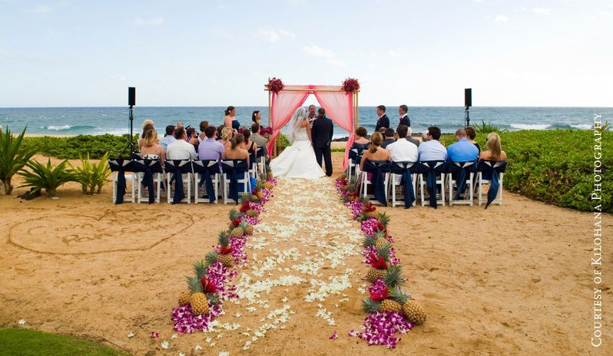 Oceanfront wedding with toes in the sand