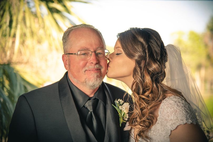 Kissing her father