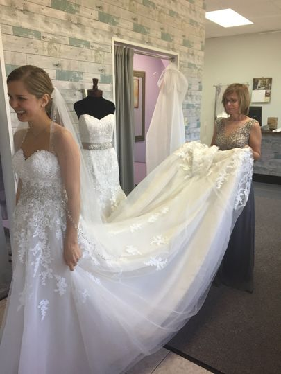 Bride fitting elegant gown
