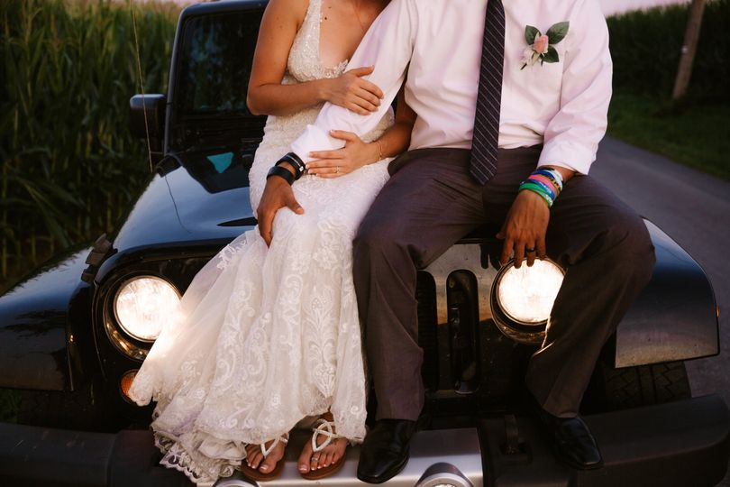 Bride and groom on Jeep
