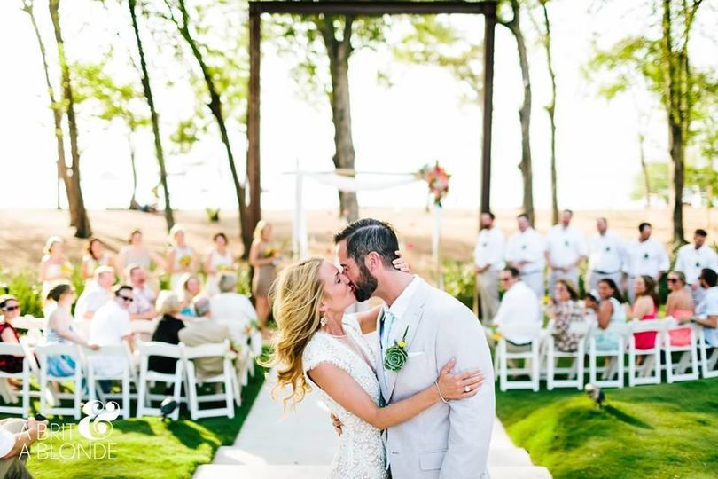 Newlyweds kissing at their ceremony