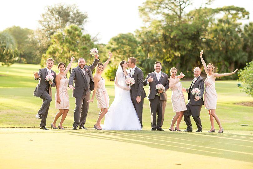Newlyweds, bridesmaids, and groomsmen