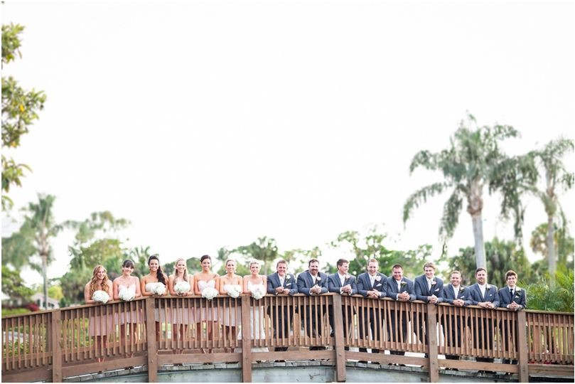 Newlyweds and their guests on the bridge