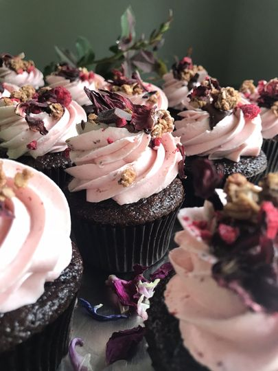 Pink icing on chocolate cupcakes