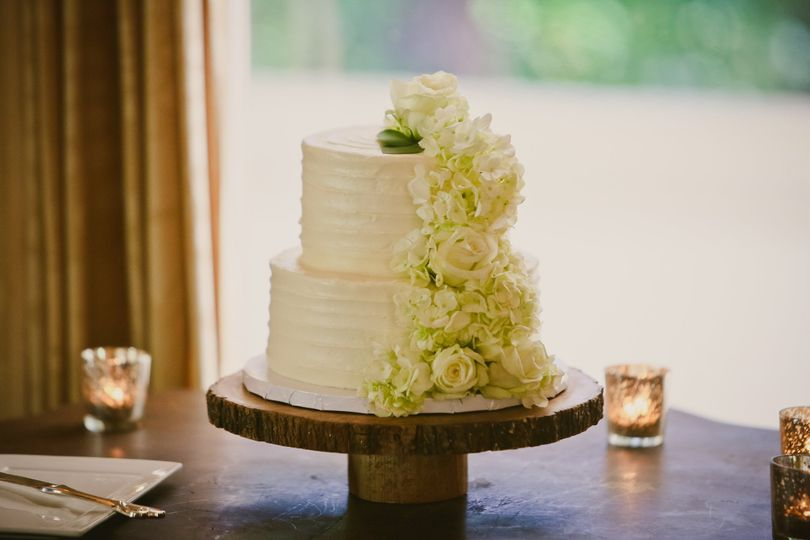 Two tier cake with cascading white flowers
