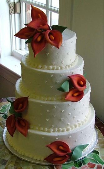 Hand made sugar cala lillies are added to a simple yet elegant cake