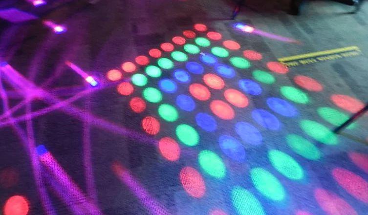 Disco lights on the dancefloor