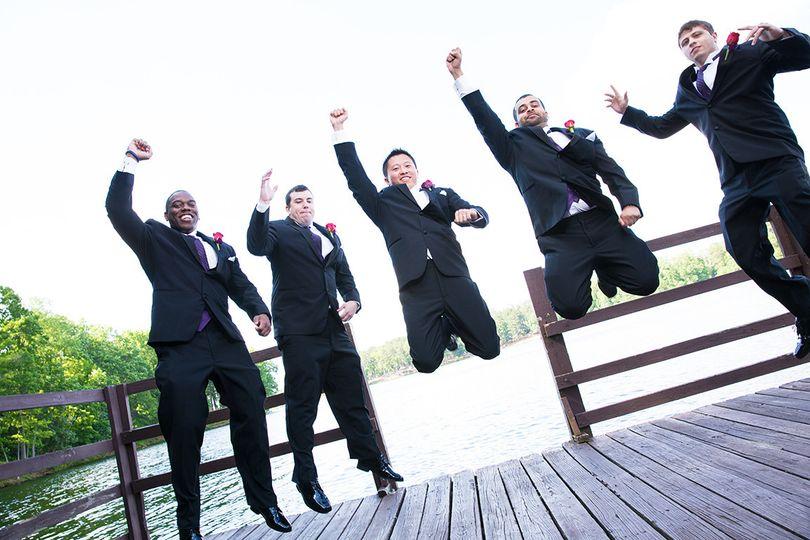 Jump shot of groom and groomsmen