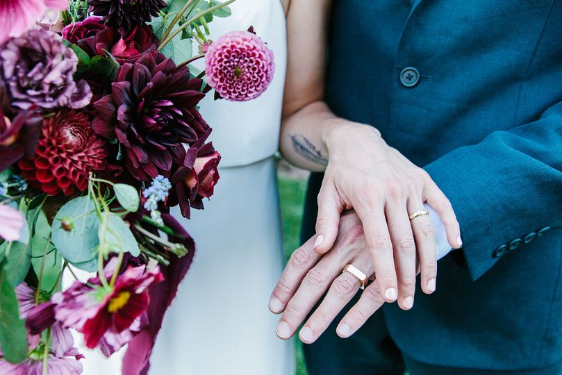 Couple's wedding ring and bouquet