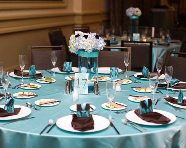Aqua blue and brown patterned favor box filled with chocolates for favors. The table number was...