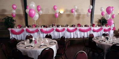 Table setup with balloons centerpiece