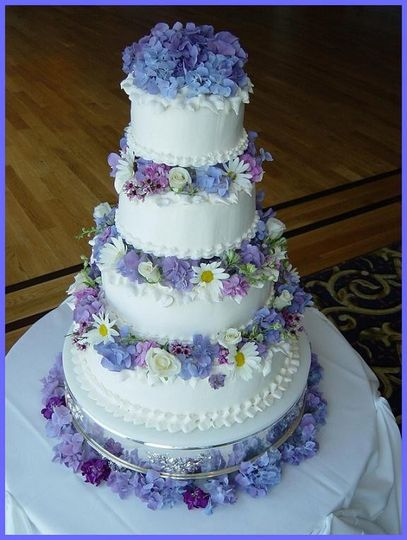 4-tier wedding cake with violets