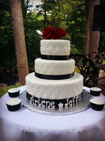 Wedding cake with black ribbons and detailing