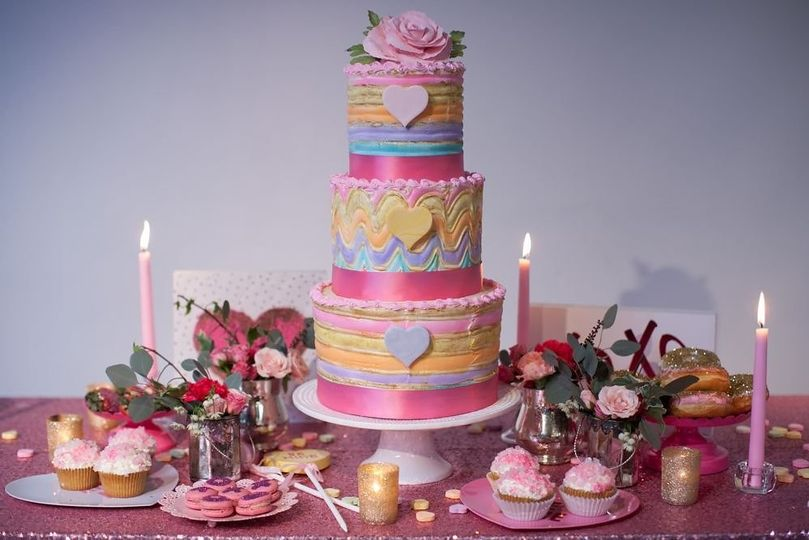 Colorful wedding cake with pink base