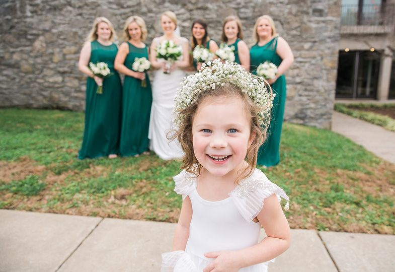 Flower girl with the bride and bridesmaids
