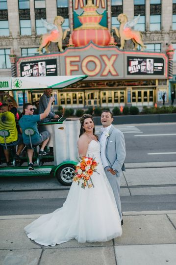 Newlyweds posing on the city street