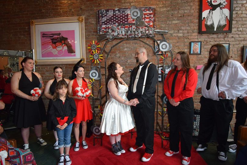 The couple with the wedding attendants