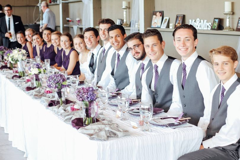 Long table for the newlyweds and their bridesmaids and groomsmen