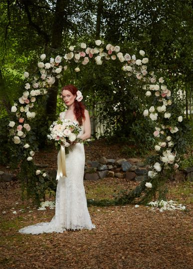 Recite your vows of love in front of our flower bedecked infinity love arch.