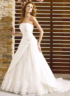 This A-line gown features a strapless neckline, asymmetric drop waist and gathered taffetta bodice....