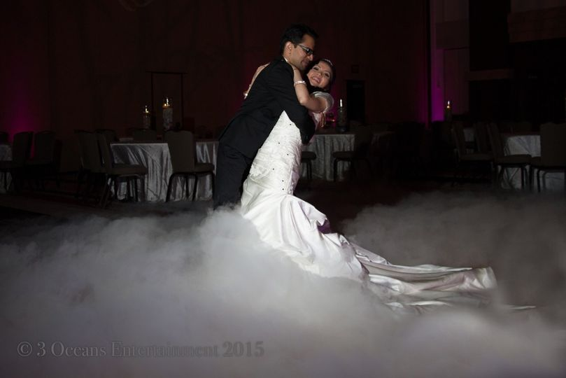 Bride and Groom Dancing on Clouds for the First Dance at their Wedding Reception