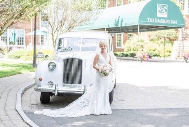 Bride photo beside the  getaway car