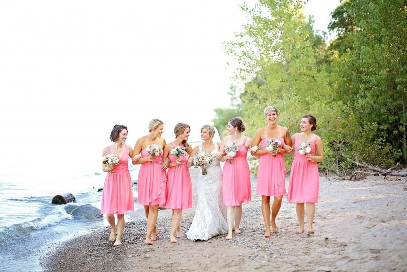 Bride and bridesmaids at the beach