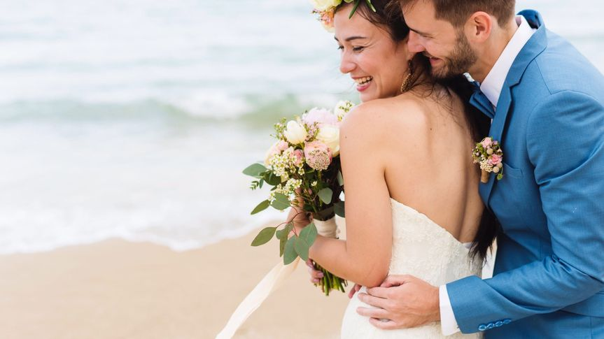 Smiling couple together on the beach