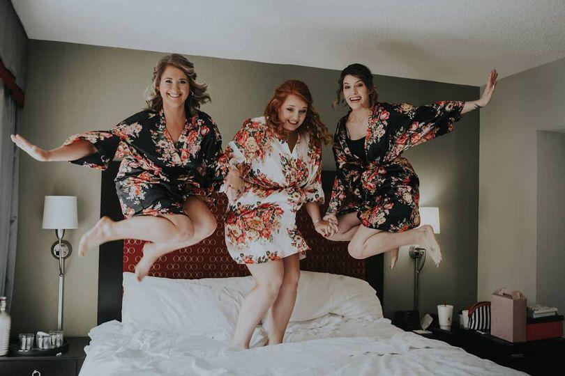 Bride and bridesmaids jumping