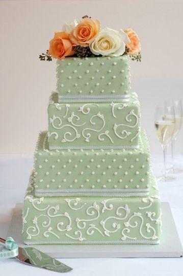 Tahitian vanilla tiered wedding cake with dulce de leche buttercream, covered in ceylon green...