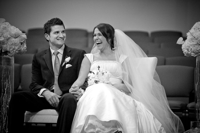 bride groom laughing holding hands 2