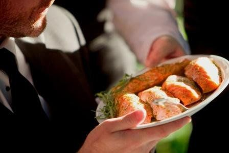 Family Style platters with fresh local Salmon prepared on-site by our Chefs