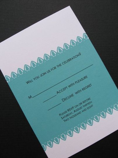 This beautiful invitation is perfect for any formal wedding! The damask design creates a lace border...