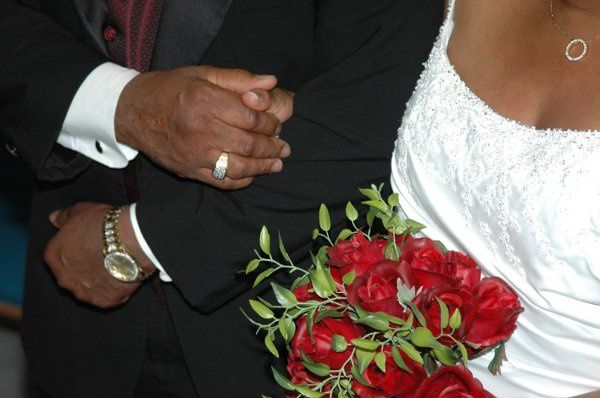 The silk red roses were hand picked by the bride. The centerpeieces were beautiful red silk roses...