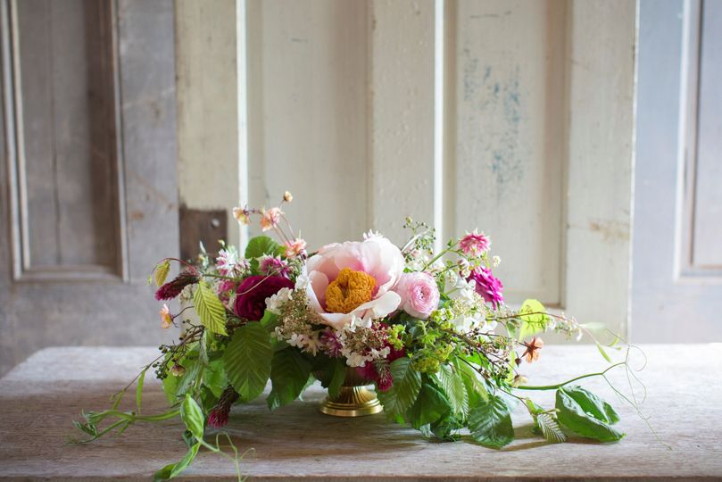 low compote centerpiece with spring seasonal flowers